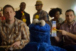 "Video Still of Cookie Monster Singing ""Share It Maybe"""